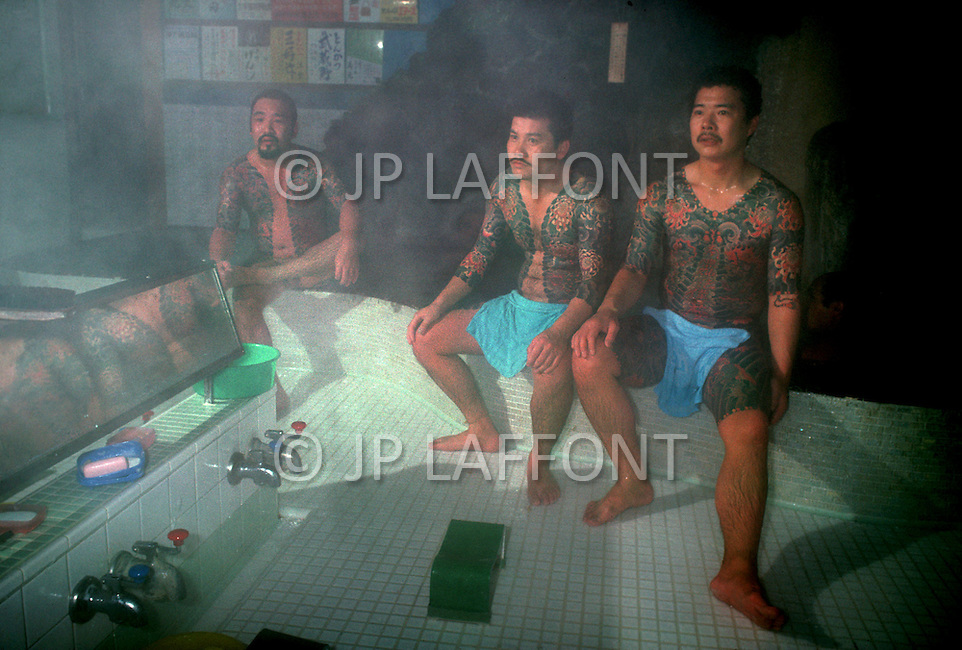 October, 1980. Tokyo, Japan. The famous Bains Tsubameyu baths in Tokyo are where the tattooed Yakuza Japanese Mafia men gather to bath.