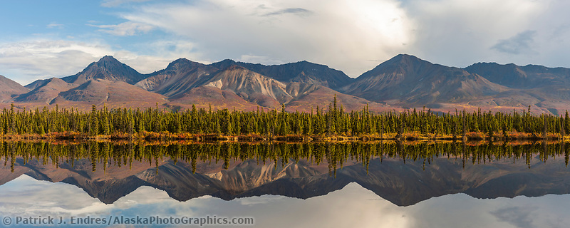 Alaska Range mountain reflection in tundra pond along the Denali highway, Interior, Alaska.
