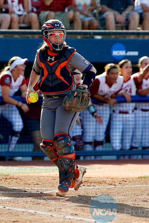 08 JUNE 2016:  Auburn catcher Carlee Wallace (0) stares down a runner at first base during the Division I Women's Softball Championship is held at ASA Hall of Fame Stadium in Oklahoma City, OK.  Shane Bevel/NCAA Photos