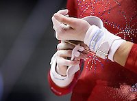 Nastia Liukin of WOGA puts on her hand protection before going on uneven bars during 2012 US Olympic Trials Gymnastics Finals at HP Pavilion in San Jose, California on July 1st, 2012.