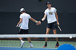 Ian Dempster (left) and Christian Seraphim of the Wake Forest Demon Deacons during their match at #3 doubles against the Texas A&M Aggies during the semifinals at the 2018 NCAA Men's Tennis Championship at the Wake Forest Tennis Center on May 21, 2018 in Winston-Salem, North Carolina. The Demon Deacons defeated the Aggies 4-3. (Brian Westerholt/Sports On Film)