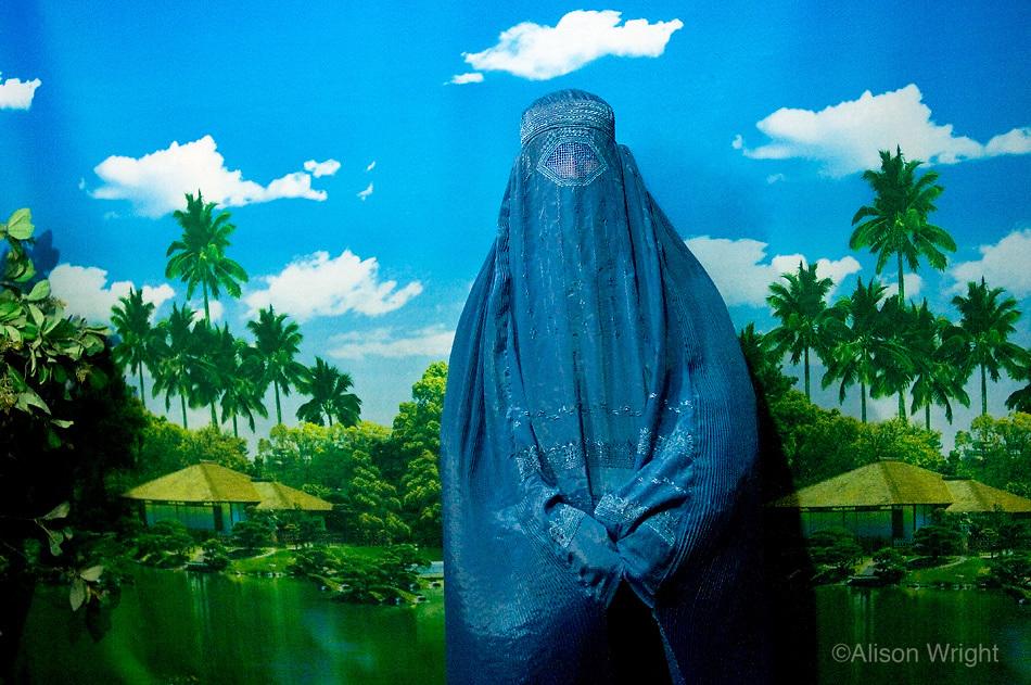 Woman in burka in photo studio