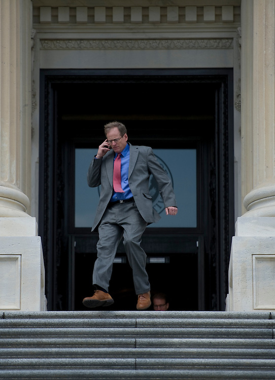 UNITED STATES - June 28: Rep. Jack Kingston, R-GA., storms out of the House Chamber cell phone in hand onto the East Front Plaza of the U.S. Capitol on June 28, 2013 after the last vote before the Independence Day recess.  (Photo By Douglas Graham/CQ Roll Call)