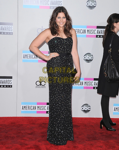 Hillary Scott of Lady Antebellum.2011 American Music Awards - Arrivals held at Nokia Theatre LA Live, Los Angeles, California, USA..November 20th, 2011.ama amas ama's full length dress hand on hip clutch bag black strapless sequins sequined .CAP/RKE/DVS .©DVS/RockinExposures/Capital Pictures.