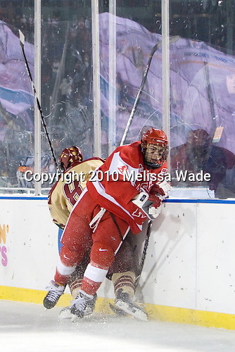 Edwin Shea (BC - 8), Zach Cohen (BU - 11) - The Boston University Terriers defeated the Boston College Eagles 3-2 on Friday, January 8, 2010, at Fenway Park in Boston, Massachusetts, as part of the Sun Life Frozen Fenway doubleheader.