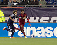 Real Salt Lake forward Paulo Araujo Jr. (23) dribbles down the wing as New England Revolution defender Kevin Alston (30) defends. In a Major League Soccer (MLS) match, Real Salt Lake defeated the New England Revolution, 2-0, at Gillette Stadium on April 9, 2011.