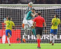 Torwart Alisson (Brasilien Brasilia) faengt gegen Mario Gomez (Deutschland Germany) - 27.03.2018: Deutschland vs. Brasilien, Olympiastadion Berlin