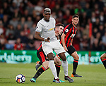 Paul Pogba of Manchester United tackled by Lewis Cook of Bournemouth during the premier league match at the Vitality Stadium, Bournemouth. Picture date 18th April 2018. Picture credit should read: David Klein/Sportimage