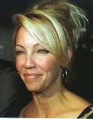 Heather Locklear poses for a photo as she arrives at the Washington Hilton in Washington, D.C. on May 23, 2000 for the launch of the Michael J. Fox Foundation for Parkinson's Research..Credit: Ron Sachs / CNP
