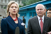 United States Secretary of State Hillary Rodham Clinton and U.S. Secretary of Defense Robert Gates speak to members of the press outside the T2 buildings in Panmunjom, the demilitarized zone that separates the two Koreas since the Korean War, north of Seoul, South Korea, Wednesday, July 21, 2010. .Mandatory Credit: Cherie Cullen - DoD via CNP