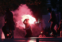 Pictured: A protester throws a flare Sunday 09 May 2016<br /> Re: Riots break out between protesters and police in Syntagma Square, while MPs in the Greek Parliament vote for new tax, pension and welfare reforms in Athens, Greece