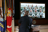 Washington, D.C. - October 13, 2005 -- United States President George W. Bush talks via video conference to United States National Guard troops from 42nd Infantry Division in Tikrit, Iraq from the Eisenhower Executive Office Building on the grounds of the White House in Washington, DC Thursday, 13 October 2005.<br /> Credit: Shawn Thew - Pool via CNP