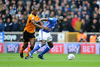 Wolverhampton Wanderers' Willy Boly vies for possession with Birmingham City's Cheick Ndoye<br /> <br /> Photographer Ashley Crowden/CameraSport<br /> <br /> The EFL Sky Bet Championship - Wolverhampton Wanderers v Birmingham City - Sunday 15th April 2018 - Molineux - Wolverhampton<br /> <br /> World Copyright &copy; 2018 CameraSport. All rights reserved. 43 Linden Ave. Countesthorpe. Leicester. England. LE8 5PG - Tel: +44 (0) 116 277 4147 - admin@camerasport.com - www.camerasport.com