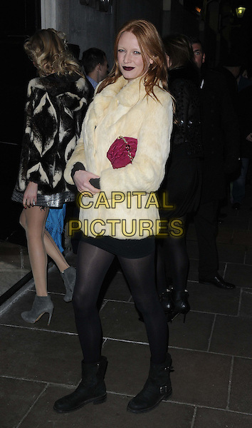 Olivia Inge.attended the BRIT Awards 2013 Warner Brothers afterparty, The Savoy Parlour Room, Savoy Hotel, The Strand, London, England..February 20th, 2013.full length black tights white fur jacket black biker boots red clutch bag.CAP/CAN.©Can Nguyen/Capital Pictures.