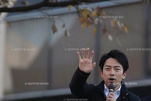 Japan's ruling Liberal Democratic Party (LDP) lawmaker  Shinjiro Koizumi delivers a speech atop a campaign car to support  a candidate in Kawasaki city, Japan, on Saturday, December 13, 2014.  (Photo by Yuriko Nakao/AFLO)
