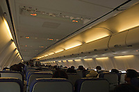 Passengers mid-flight on a plane to China.