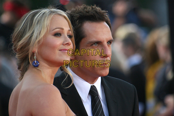 "CHRISTINE TAYLOR & BEN STILLER.""Tropic Thunder"" Los Angeles Premiere at Mann's Village Theatre, Westwood, California, USA. .August 11th, 2008 .headshot portrait dangling blue earrings black strapless profile married husband wife .CAP/ADM/BP.©Byron Purvis/AdMedia/Capital Pictures."