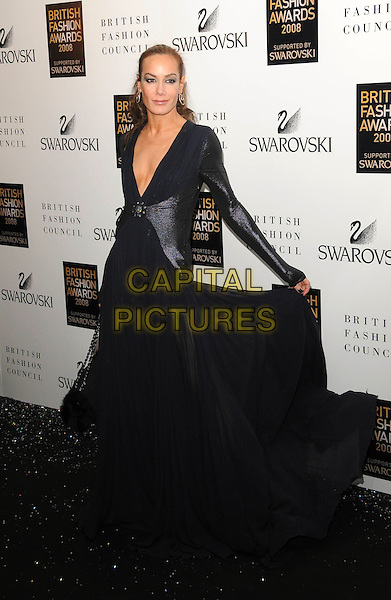 TARA PALMER TOMKINSON.Attending the British Fashion Awards 2008 held at The Lawrence Hall in London, England, UK, .November 25th 2008..Arrivals full length TPT full length long sleeved navy blue long maxi dress low cut v neck sheer plunging neckline gown leather shiny sleeves hand holding.CAP/CAS.©Bob Cass/Capital Pictures