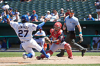 Peoria Chiefs catcher Jose Godoy (27) tags out Eloy Jimenez (27) sliding into home as umpire Andy Stukel looks on during the first game of a doubleheader against the South Bend Cubs on July 25, 2016 at Four Winds Field in South Bend, Indiana.  South Bend defeated Peoria 9-8.  (Mike Janes/Four Seam Images)