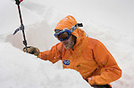 Sierra Avalanche Center forecaster Andy Anderson examines the layers of snow in a snowpit he dug near the Sierra Crest in the vicinity of Sugarbowl Ski Resort during Thursday's storm. The information gathered is used to create the center's daily online avalanche forecasts.