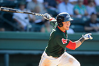 Catcher Carlos Coste (7) of the Greenville Drive bats in a game against the Savannah Sand Gnats on Sunday, June 22, 2014, at Fluor Field at the West End in Greenville, South Carolina. Greenville won, 7-3. (Tom Priddy/Four Seam Images)