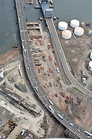"Early Eastbound Approach Construction, Pearl Harbor Memorial ""Q"" Bridge, just east of Interstate I-95 I-91 CT Route 34 Interchanges. Water Street and Tomlinson Bridge on right. Details of approaches, overpasses, ramps & roadway near or within I-95 New Haven Harbor Crossing Corridor projects confines. Photography taken at the beginning of Contract B1 & E1"