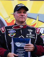 Sep 13, 2013; Charlotte, NC, USA; NHRA funny car driver Tim Wilkerson during qualifying for the Carolina Nationals at zMax Dragway. Mandatory Credit: Mark J. Rebilas-