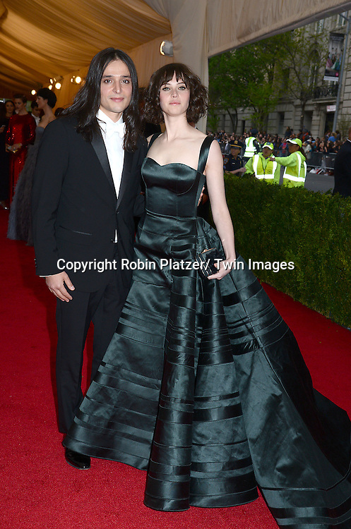 Olivier Theyskens and Felicity Jones attends the Costume Institute Benefit on May 5, 2014 at the Metropolitan Museum of Art in New York City, NY, USA. The gala celebrated the opening of Charles James: Beyond Fashion and the new Anna Wintour Costume Center.