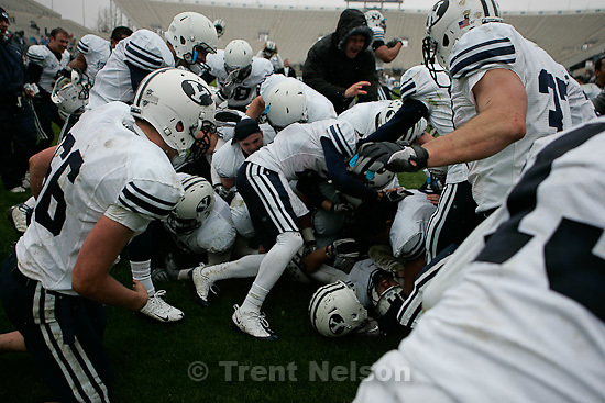 Trent Nelson  |  The Salt Lake Tribune.BYU tight end Bryan Sampson (86) is tackled by teammates after his game-winning reception on a two-point conversion in overtime, at the spring football game at LaVell Edwards Stadium in Provo, Utah, Saturday, April 9, 2011.