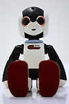 """A communication robot called """"Robi"""" is seated during a press preview for """"Robi cafe"""" where visitors can interact with the robots while enjoying meals and drinks in Tokyo, Thursday, January 15, 2015. The robot can be built by assembling parts sent along with a weekly magazine by Deagostini. The cafe will open from January 16 until February 8. (Photo by Yuriko Nakao/AFLO)"""