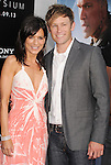 WESTWOOD, CA- AUGUST 07: Actress Perrey Reeves and guest arrive at the Los Angeles premiere of 'Elysium' at Regency Village Theatre on August 7, 2013 in Westwood, California.