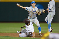 UCLA shortstop Pat Valaika (10) turns a double play in the eighth inning against the Mississippi State Bulldogs during Game 1 of the 2013 Men's College World Series Final on June 24, 2013 at TD Ameritrade Park in Omaha, Nebraska. The Bruins defeated the Bulldogs 2-1, taking a 1-0 lead in the best of 3 series. (Andrew Woolley/Four Seam Images)