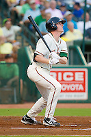 Colin Moran (14) of the Greensboro Grasshoppers follows through on his swing against the Charleston RiverDogs at NewBridge Bank Park on July 17, 2013 in Greensboro, North Carolina.  The Grasshoppers defeated the RiverDogs 4-3.  (Brian Westerholt/Four Seam Images)