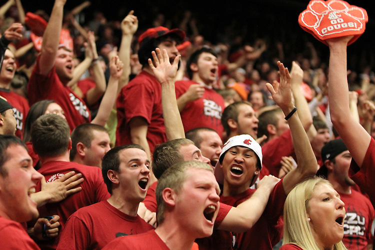 The Washington State student section, the ZZU CRU, goes crazy after a thunderous Reggie Moore alley-oop dunk off of a feed from Faisel Aden during the Cougars 87-80 Pac-10 conference victory over arch-rival Washington at Friel Court at Beasley Coliseum in Pullman, Washington, on January 30, 2011.