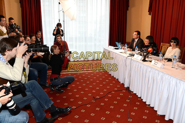 Mireille Mathieu.Press conference, National Hotel, Moscow, Russia..1st November 2012.microphone white top sunglasses shades  half length table sitting photographers .CAP/PER/AL.© AL/Persona/CapitalPictures