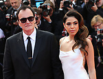 "72nd edition of the Cannes Film Festival in Cannes in Cannes, southern France on May 21, 2019. Red Carpet for the screening of the film ""Once Upon a Time... in Hollywood"" US film director, screenwriter, producer, and actor Quentin Tarantino and his wife  Israeli singer Daniella Pick on the red carpet.<br /> © Pierre Teyssot / Maxppp"