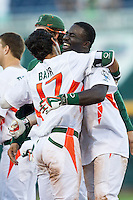 Miami Hurricanes outfielder Jacob Heyward (24) celebrates after driving in the winning run during the NCAA College baseball World Series against the Arkansas Razorbacks  on June 15, 2015 at TD Ameritrade Park in Omaha, Nebraska. Miami beat Arkansas 4-3. (Andrew Woolley/Four Seam Images)