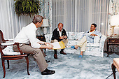United States President Ronald Reagan, right, is briefed by US Secretary of State George Schultz, center, and Robert McFarlane, Assistant to the President for National Security Affairs, left, at 5:15am, Saturday, October 22, 1983 in Augusta, Georgia regarding an urgent request from five member nations of the Eastern Caribbean States on the situation in Grenada.<br /> Mandatory Credit: Bill Fitz-Patrick / White House via CNP