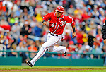 1 May 2011: Washington Nationals infielder Ian Desmond rounds second as he streaks to third during a game against the San Francisco Giants at Nationals Park in Washington, District of Columbia. The Nationals defeated the Giants 5-2. Mandatory Credit: Ed Wolfstein Photo