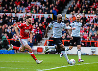 Derby County's defender Andre Wisdom (14) beats Nottingham Forest's forward Ben Brereton (17) to the ball during the Sky Bet Championship match between Nottingham Forest and Derby County at the City Ground, Nottingham, England on 10 March 2018. Photo by Stephen Buckley / PRiME Media Images.