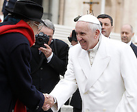 Papa Francesco saluta il cantante Teddy Reno al termine dell'udienza generale del mercoledi' in Piazza San Pietro, Citta' del Vaticano, 16 dicembre 2015.<br /> Pope Francis greets Italian singer Teddy Reno at the end of his weekly general audience in St. Peter's Square at the Vatican, 16 December 2015.<br /> UPDATE IMAGES PRESS/Isabella Bonotto<br /> <br /> STRICTLY ONLY FOR EDITORIAL USE<br /> <br /> *** ITALY AND GERMANY OUT ***