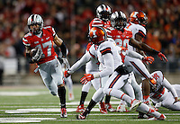 Ohio State Buckeyes running back Jalin Marshall (17) returns a punt in the second quarter the college football game between the Ohio State Buckeyes and the Illinois Fighting Illini at Ohio Stadium in Columbus, Saturday night, November 1, 2014. (The Columbus Dispatch / Eamon Queeney)