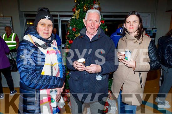Sonya Doyle, John McKiernan and Lorraine Roche at the Lighting of the Light to Remember Tree service in the UHK on Saturday evening.