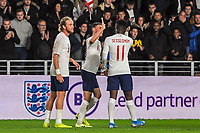 England Under 21's midfielder Phil Foden (10)  high fives England Under 21's defender Steven Sessegnon (11) during the UEFA Euro U21 Qualifying match between England U21 & Kosovo U21 at KCOM Craven Park, Hull, England on 9 September 2019. Photo by Stephen Buckley / PRiME Media Images.
