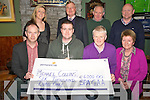 Tadhg Hickey, Spa Gaa Club pitucred as he presented a cheque for ?6,000 to Michael Collins, after he won the Spa GAA lotto, in the Village Inn, KIlcummin on Wednesday night. Also pictured are Gerard Mangan, Marian Collins, Sinéad Collins, Jim Gleeson, Johnny Cronin and Andy O'Sullivan.