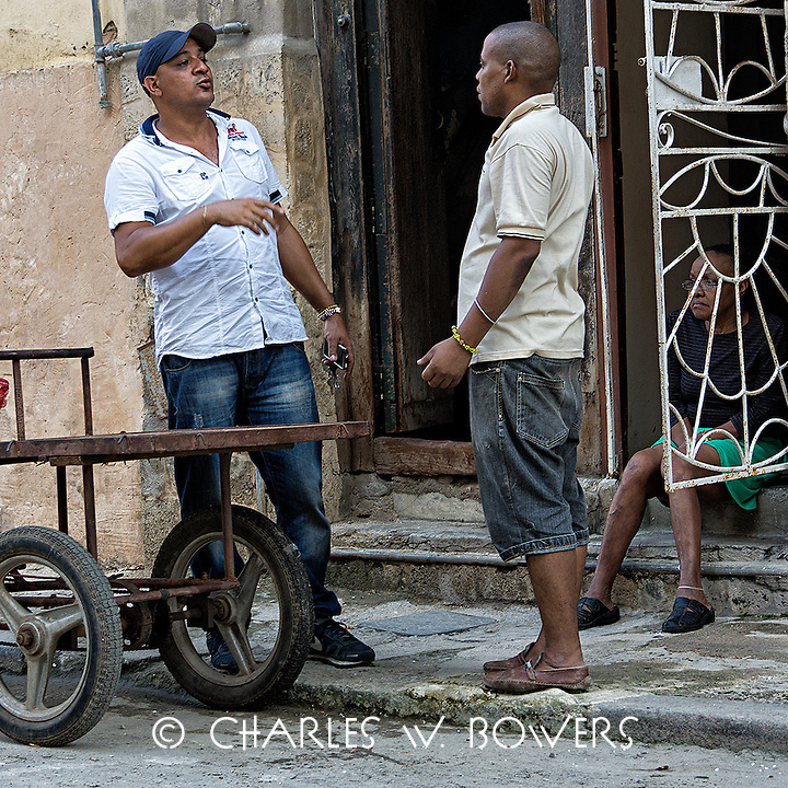 Faces Of Cuba - Asking a good friend for his opinion.<br /> <br /> -Limited Edition of 50 prints.
