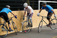 17 AUG 2014 - LONDON, GBR - A player attempts to retain control of the ball during a game at the 2014 London Open bike polo tournament in Highbury Fields in London, Great Britain (PHOTO COPYRIGHT © 2014 NIGEL FARROW, ALL RIGHTS RESERVED)