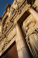 View from below of the baroque facade of the entrance to the church, 16th century, of Monestir de Poblet, 1151, Vimbodi, Catalonia, Spain, pictured on May 20, 2006, in the evening. The Monastery of Poblet belongs to the Cistercian Order and was founded by French monks. Originally, Cistercian architecture, like the rules of the order, was frugal. But continuous additions  including late Gothic and Baroque, such as this facade, eventually made Poblet one of the largest monasteries in Spain which was later used as a fortress and royal palace. It was closed in 1835 by the Spanish State but refounded in 1940 by Italian Cistercians. It is a UNESCO World Heritage Site. Picture by Manuel Cohen.