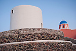 Windmill tower and blue-dome church, Oia, Santorini, Greece