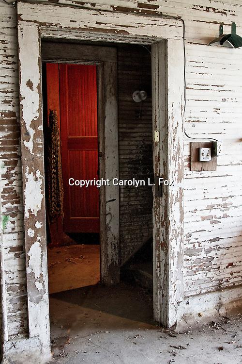Light shines into a hallway in an old, historic dairy barn at Longview Farms near Kansas City, Missouri.